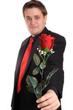 Young man offering you a rose Stock Photography