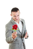 Young man offering you a rose Stock Photos