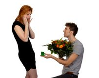 Young man offers his girlfriend flowers Stock Photos