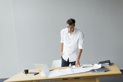 Young man in office. Young man in the office Stock Image