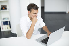 Young man in office Royalty Free Stock Photos