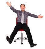 Young man in office chair Stock Photos