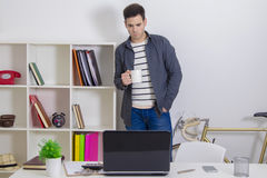 Young man in the office Stock Photos