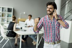 Young man in office Royalty Free Stock Images