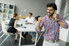 Young man in office Royalty Free Stock Image