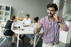 Young man in office Stock Photo