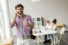 Young man in office Stock Photos
