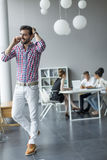 Young man in the office Royalty Free Stock Photos