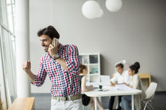 Young man in the office Royalty Free Stock Photography
