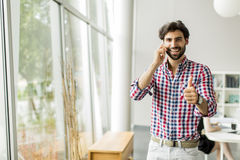 Young man in the office Stock Images