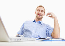 Young man at office smiling Royalty Free Stock Photography
