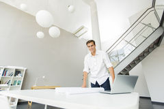 Young man in the office. Young man standing in the office Stock Photography