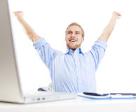 Young man at office triumphing Stock Image