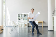 Young man in the office. Young man working in the office Royalty Free Stock Image