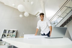 Young man in the office. Young man working in the office Stock Photo