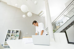 Young man in the office. Young man working in the office Stock Images