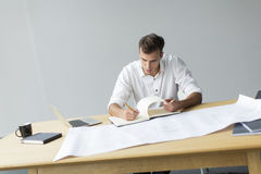 Young man in the office. Young man working in the office Royalty Free Stock Photos