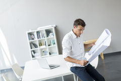 Young man in the office. Young man working in the office Royalty Free Stock Images