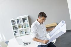Young man in the office. Young man working in the office Royalty Free Stock Photography