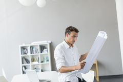 Young man in the office. Young man working in the office Royalty Free Stock Photo