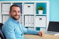 Young man in office Royalty Free Stock Photo