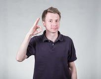 Young man with ok sign Stock Photos