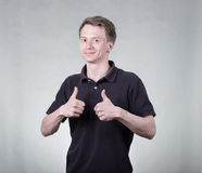 Young man with ok sign Royalty Free Stock Image
