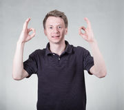 Young man with ok sign Royalty Free Stock Images
