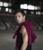 Serious young man in an old stadium, portrait Royalty Free Stock Photos