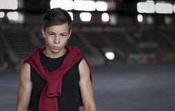 Serious young man in an old stadium, portrait Stock Images