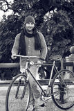 Young man with old bicycle in black and white Stock Images