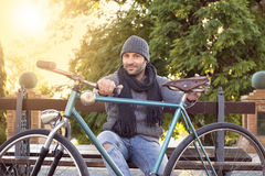 Young man with old bicycle Royalty Free Stock Photos