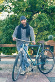Young man with old bicycle Royalty Free Stock Photography