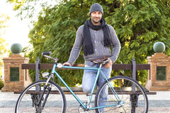 Young man with old bicycle Royalty Free Stock Images