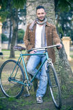 Young man with old bicycle Royalty Free Stock Image
