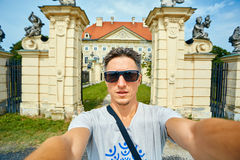 Young man on the old castle background Royalty Free Stock Photo