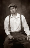 Young Man in Old Fashioned Attire. Young Man in Old Fashioned Cival War era attire. Suspenders and newsboy cap royalty free stock image