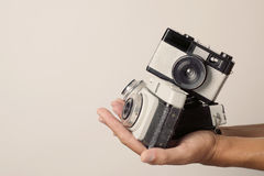Young man with old film cameras Royalty Free Stock Photo