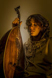 Young Man with Old Oud Guitar Lute