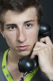A young man with an old phone Stock Image