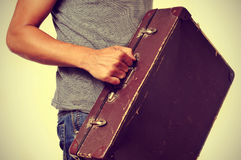 Young man with old suitcase Royalty Free Stock Photography