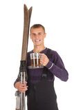 Young man with old wooden ski and mug of beer Royalty Free Stock Photo