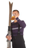 Young man with old wooden ski and mug of beer Royalty Free Stock Images