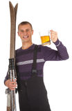 Young man with old wooden ski and mug of beer Stock Photos