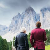 Young man and older man admiring view of Dolomite mountains in South Tyrol / Alto Adige, Italy Royalty Free Stock Photos