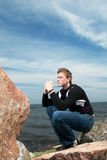 Young Man On The Rocks On The Background Of Sea An Royalty Free Stock Images