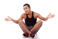 Young man with open arms, sitting on floor Royalty Free Stock Photo