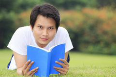 Young man open a book Stock Photography