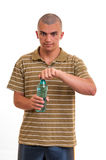 Young man open a bottle of water Royalty Free Stock Image