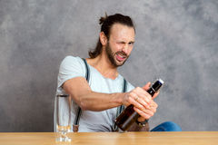 Young man opening a beer bottle Stock Photos